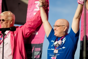 Saralyn Carrillo joins hands with other breast cancer survivors at the Opening Ceremony of the Chicago 3-Day