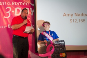 Amy accepts a Bank of America recognition for Top Fundraiser