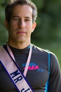 Matthew Pickus, founder of the 60-Mile Men, will cross his 1000th mile today on the Michigan 3-Day in support of finding a cure for breast cancer