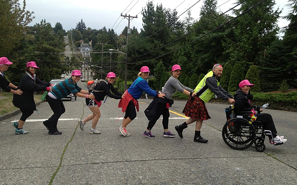 "Team ""The Faithful Fighters"" push each other along the Seattle 3-Day"