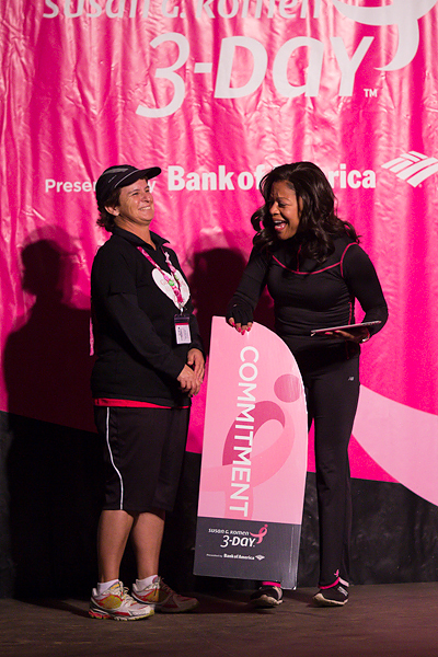 Lauren accepts the Milestone Award from Dr. Sheri on Friday night of the San Diego 3-Day