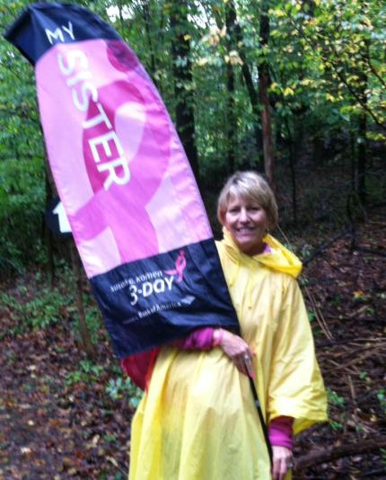 """Jill R., in Washington, D.C., 2013. """"Wet but proudly carrying the sister flag for my sister Judy."""""""
