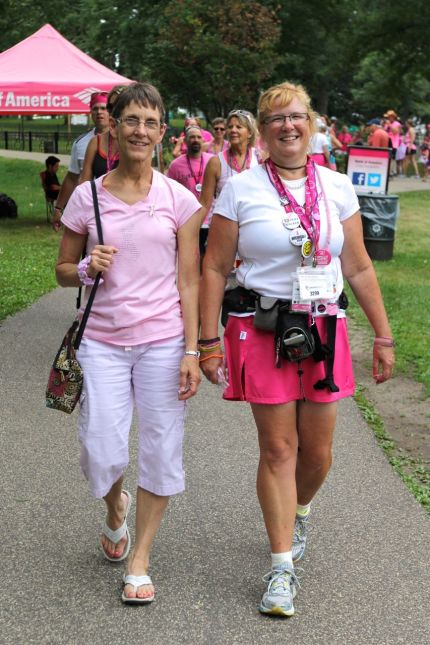 Pala walks with her friend Becky, who also helps her with her annual fundraising garage sale
