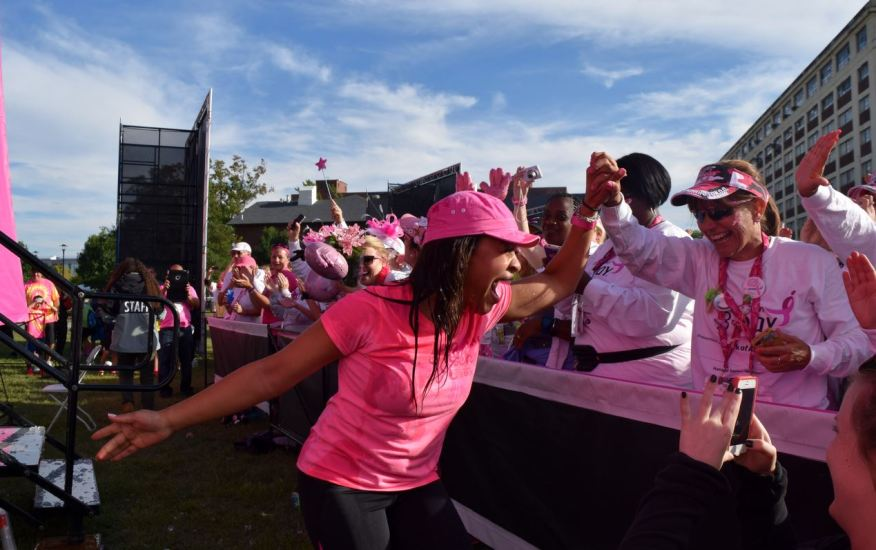 Dr. Sheri high-fives 3-Day participants after getting soaked in the ice bucket challenge in Philadelphia this summer.
